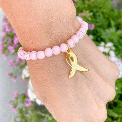 Pink Ribbon armbandje drip-art roze en bedel goud